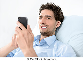 Man using a mobile smart phone - Young handsome man using...
