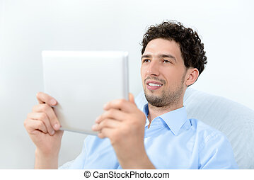 Man looking on digital tablet - Young handsome man looking...
