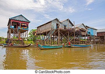 Floating village - Homes on stilts on the floating village...