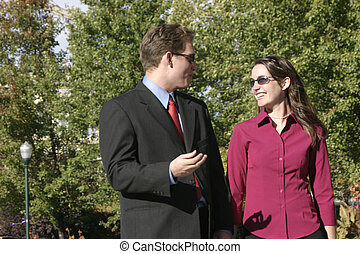 business people - businessman and businesswoman talk...