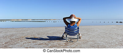 Woman relaxed sunbath at outback lake - Sexy mature woman...