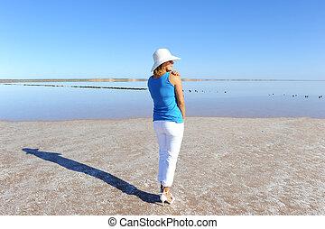 Woman outback lake Australia