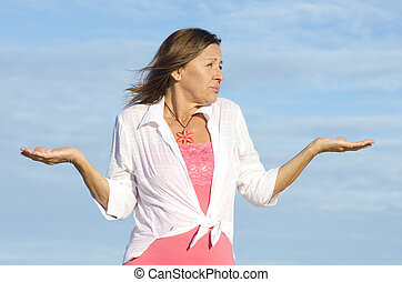Ignorant, unaware woman gesturing isolated - Mature woman...