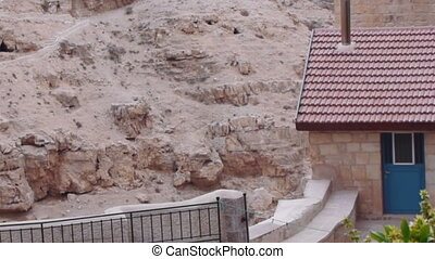 Monks' cells in the rock of Kidron valley, Saint Savas monastery near Jerusalem, Israel
