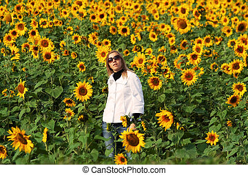 Beautiful lady with sunflowers