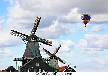 Picturesque windmills and flying colorful balloon