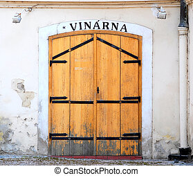 Shabby wooden door of wine-house - Shabby wooden door of an...