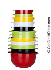 Bowls - Colorful Kitchen bowls stacked up isolated in white...