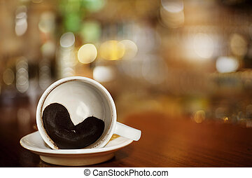 cup of coffee with Heart of Coffee Grounds on Bar, full...