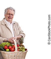 Healthy senior man with Vegetable shopping bag Isolated on...