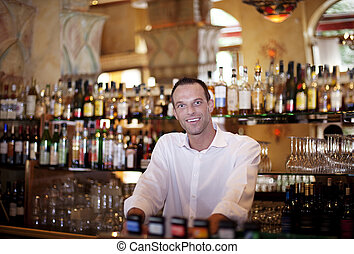 Friendly Bar Tender. Our very ownCocktail ready to serve you