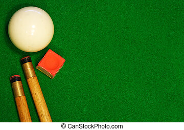 billiards table cues and cue ball - A green cloth billiards...