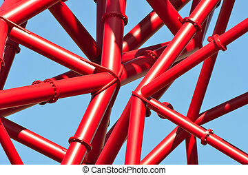 Red piping against blue sky
