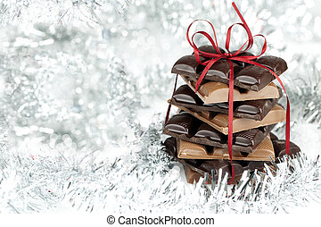 Christmas chocolate stack present on a fluffy background