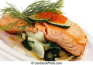 Broiled salmon steak with spinach and red caviar
