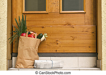 delivery service- Grocery bag and Newspaper at the doorstep