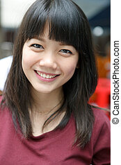 asian woman with forelock hair nice emotion