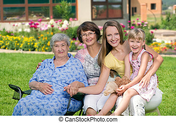 Four generations of women at countryside