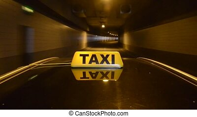 Tunnel Taxi - Taxicab driving into a tunnel and emerging on...