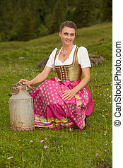 milkmaid from the Alps - Young woman in traditional dress...