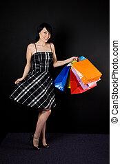 Shopping woman - A shot of a beautiful woman carrying...