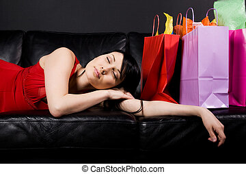 Shopping woman - A shot of a tired and exhausted beautiful...