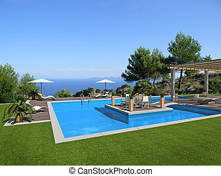 swimming pool with an islet in the middle and a beautiful...