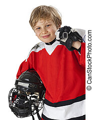 Young hockey player - A young hockey player in uniform,...