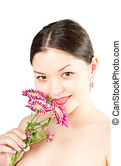 close up of  kazakh  beautiful woman with flowers on white background