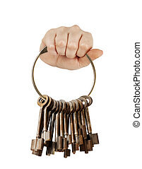 Fist with bunch of keys - Fist with bunch of old keys on a...