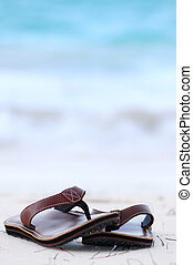Flipflops on a sandy beach - Flipflops on a sandy ocean...