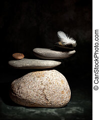 Zen Corporate - Pile of pebble Stones and White Feather over...