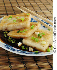 Taro Cakes in Sauce - Taro cakes are a common dim sum dish...