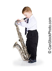 The little boy with a saxophone in hands