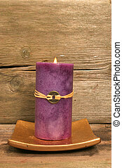 Purple Feng Shui candle - Purple fegShui candle against wood
