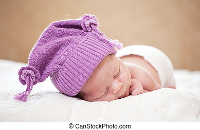 sleeping newborn baby at the age of 14 days - newborn baby...
