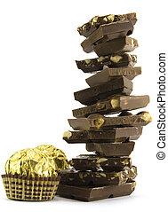 chocolate pyramid and two gold balls