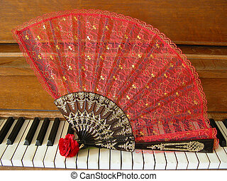 Antique Piano, Fan & Rose - A red fan and rose are displayed...