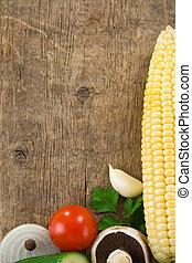 Healthy vegetable food on wood background