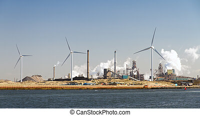 Industry and turbines - Heavy industry and wind turbines in...