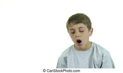 Yawning boy - A boy yawning, isolated on white