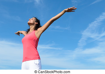 Woman day dream - Cheerful woman raising arms like flying...