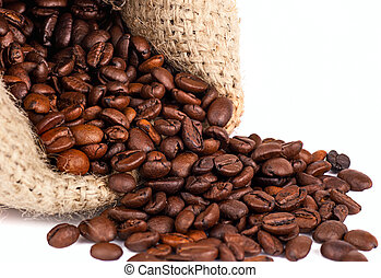 scattered coffee grains on a white background