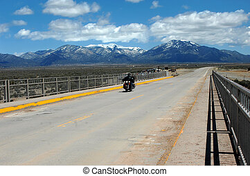 Biker View - Biker crosses the long span Rio Grande Gorge...