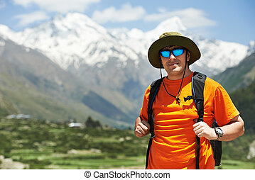 Tourist hiker with backpack in mountains