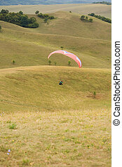 Paragliding fun outdoors in nature - Action shots of...