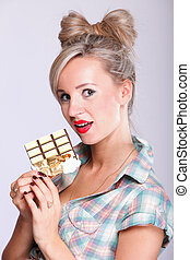 pinup girl Woman eating chocolate portrait - Cheerful pin up...