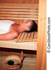 Beautiful woman relaxing a sauna