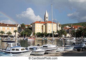 Rainbow and boats in Supetar, Brach island, Croatia