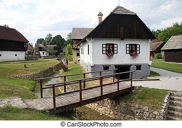 Bridge and house - Wooden bridge and farm house in...